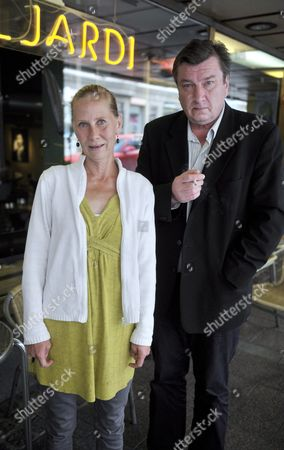 Actress Kati Outinen and film director Aki Kaurismaki at a press conference for his film 'Le Havre'