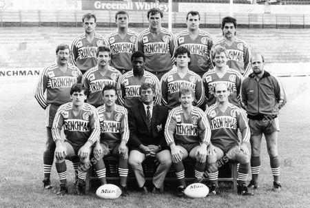 Salford Rugby League Club 1987 Squad. Front Row (l-r): Ged Byrne Ken Jones Kevin Ashcroft (manager) Paul Groves Mick Mctigue. Middle Row (l-r): Bob Welding (coach) Adrian Beckett Roy Wiltshire Chris Whiteney Andy Burgess Tom Grainey (coach). Back Row (l-r): Ian Marsh Peter Regan Steve Herbert David Major Mark Moran.