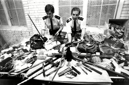 Editorial picture of P.c. Shaun Gleeson (left) And Sgt. Colin Levy With All The Goods And Weapons Found In The Streets After The Nottingh Hill Carnival.