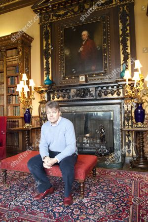 Lord Carnarvon in the Library at Highclere Castle