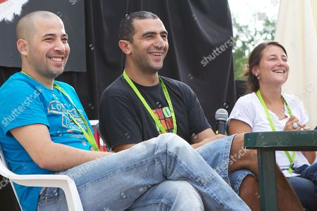 Stock Photo of Tarek Aggoun, Hakim Zouhani and Carine May talking about their film 'Rue des cites'