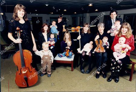 Stock Image of Eight Members Of The Bournemouth Symphony Orchestra Have Become Parents In The Past Year. They Include: Piccolo Player Barbara Brown 28 Mother Of 13-day-old Christoper); Viola Player Alison Kay And Principal Oboeist Ed Kay Are Expecting Their First Baby At Christmas; Violinist Moira Alabaster (hugh Three Months); Violinist Karen Leach (david Six Months); General Manager Cathy Nelson (daniel Three Months); Emma Fisher Married To Violinist Tim (william Nine Months); Education Director Andrew Burn (angharad Three Months); Sponsorship Co-ordinator Verity Smith (zoe One); Cellists Phillipa Eggington And Garry Stevens (james One); And Two More Expectant Mothers Cathy Jackson Married To Stage Manager Bob And Anna Thierfeldt Married To Percussionist Peter.
