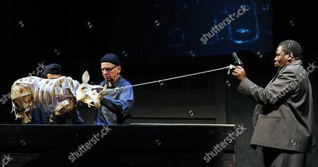 Adrian Kohler and Mncedisi Shabangu manipulate puppets