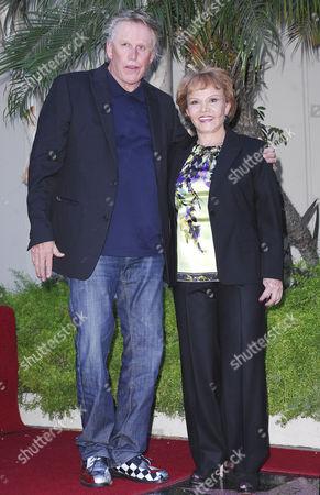 Gary Busey, Maria Elena Holly
