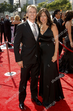 Stock Picture of Phil Keoghan and wife Louise Rodrigues