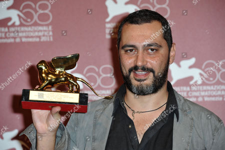 Guido Lombardi with Lion of the Future Luigi De Laurentiis Venice Award