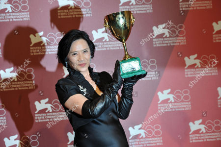 Stock Image of Deannie Yip with Best Actress Award
