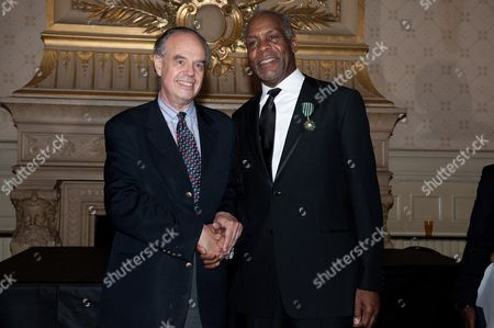 Danny Glover poses with French Culture Minister Frederic Mitterand after being awarded Commmander of the order of Arts and Letters