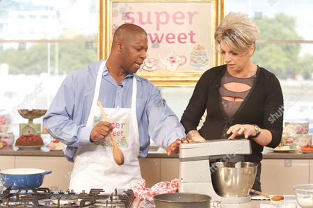 Richard with chef Silvena Rowe to help with his Caribbean Cake.