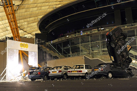 Editorial photo of Stuntman Rocky Taylor breaks the Guinness World Record for largest breakaway glass structure smashed by a car, O2 Arena, London, Britain - 13 Sep 2011