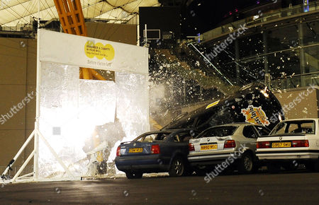 Editorial image of Stuntman Rocky Taylor breaks the Guinness World Record for largest breakaway glass structure smashed by a car, O2 Arena, London, Britain - 13 Sep 2011