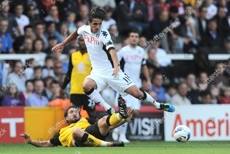 Brian Ruiz of Fulham is tackled by Gael Givet of Blackburn Rovers