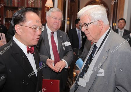 Sir Donald Tsang Yam-kuen, GBM, KBE, Chief Executive and President of the Executive Council of the Government of Hong Kong and Lord Geoffrey Howe