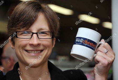 Claire Robertson holding a mug branded with the new 'Wellchester' name