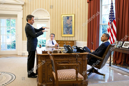 President Barack Obama meets with Treasury Secretary Timothy Geithner and National Economic Council Director Gene B Sperling in the Oval Office of the White House in Washington, D.C