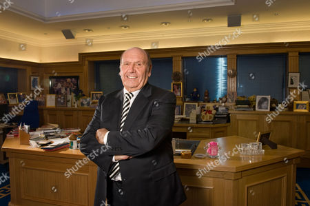 Stock Photo of Founder and chairman of Clinton Cards, Don Lewin in his office in Essex