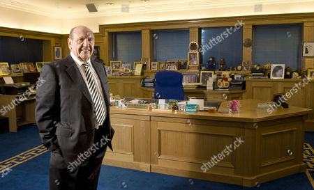 Founder and chairman of Clinton Cards, Don Lewin in his office in Essex