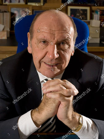 Stock Image of Founder and chairman of Clinton Cards, Don Lewin in his office in Essex