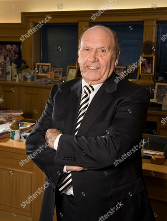 Stock Picture of Founder and chairman of Clinton Cards, Don Lewin in his office in Essex