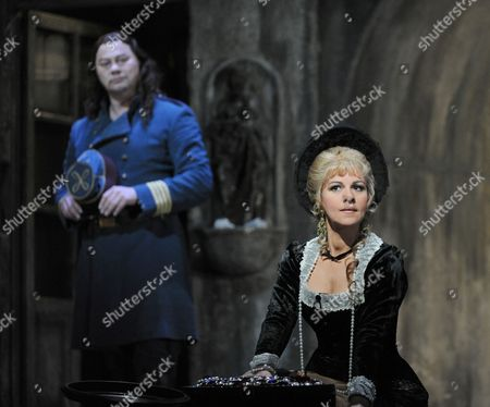 Rene Pape as Mephistopheles and Angela Gheorghiu as Marguerite