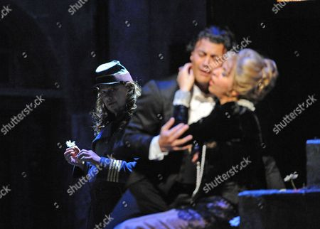 Rene Pape as Mephistopheles, Vittorio Grigolo as Faust and Angela Gheorghiu as Marguerite