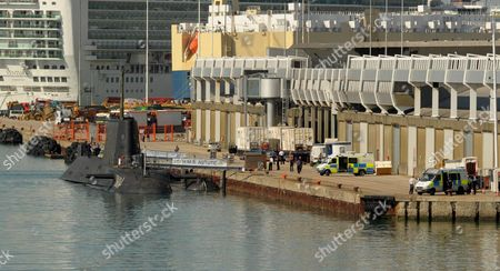 Emergency services surround the HMS Astute the day of the shooting