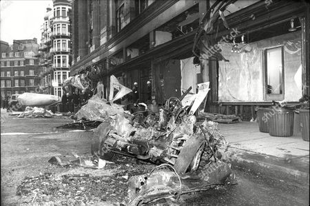 Scene Outside Harrods After An I.r.a. Car Bomb Exploded. The Bomb Contained Between 25 And 30 Lb (14 Kg) Of Explosives And Was Left In A 1972 Blue Austin 1300 Gt Four Door Saloon With A Black Vinyl Roof Registration Kfp 252k. It Was Parked Outside The Side Entrance Of Harrods On Hans Crescent And Set To Be Detonated By A Timer. At 12:44 A Man Using An Ira Codeword Phoned The Central London Branch Of The Samaritans.[1] The Caller Said There Were Bombs Inside And Outside Harrods Specifying The Registration Number Of The Car But Not Its Make Or Colour. At About 13:21 Four Police Officers In A Car A Dog Handler And An Officer On Foot Approached The Car When The Bomb Went Off. The Police Car Absorbed Much Of The Blast Probably Reducing Other Casualties. Six People Were Killed; Three Passers-by (including One Citizen Of The United States) And Three Metropolitan Police Officers. Those Killed Were: Philip Geddes (journalist 24); Kenneth Salvesen (28); Jasmine Cochrane-patrick (25); Police Sergeant Noel Lane (28); And Police Constable Jane Arbuthnot (22). Police Inspector Stephen Dodd (34) Was Fatally Injured And Died On 24 December. Police Constable Jon Gordon Survived But Lost Both Legs And Part Of A Hand In The Blast. At The Time Of The First Explosion A Second Warning Call Was Made By The Ira. The Caller Stated That A Bomb Had Been Left In The C&a Department Store On The East Side Of Oxford Street. Police Cleared The Area And Cordoned It Off But This Claim Was Found To Be False