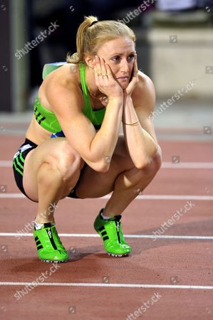 Stock Picture of Sally Pierson falls during her 100m hurdle final