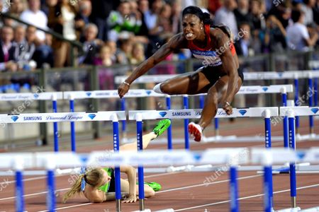 Stock Photo of Sally Pierson falls during her 100m hurdle final
