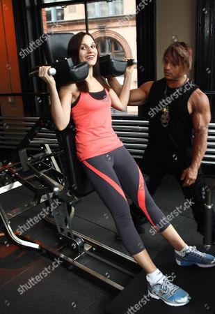 Kara DioGuardi and trainer