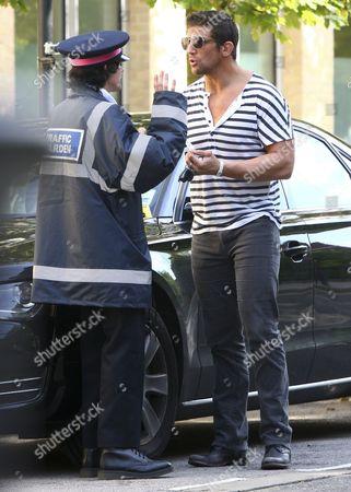 Alex Reid (R) talking to the 'traffic warden' - comedian Ross Lee