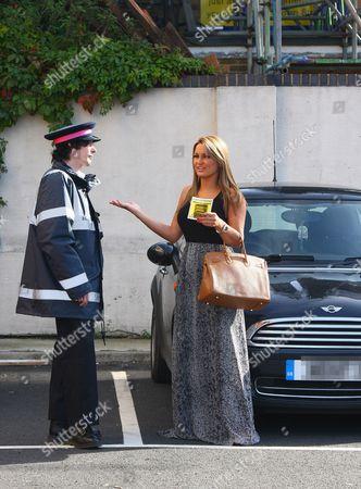 Sam Faiers (R) talking to 'traffic warden' - comedian Ross Lee