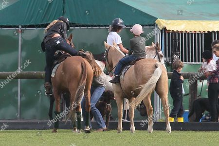 Editorial image of Elle Macpherson and her sons horse riding at Richmond Polo Club, London, Britain - 25 Sep 2011