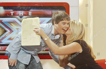 Stock Picture of Luke Lucas kisses Holly Willoughby