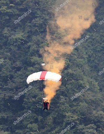 Wingsuit pilot Jeb Corliss flies across the sky