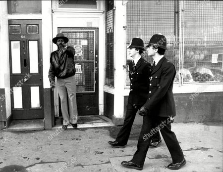 Editorial photo of Brixton Police Neighbourhood Team Patrol Railton Road Brixton South London. Pc's Chris Morley (l) And Stephen Wilkinson Meet The Locals.