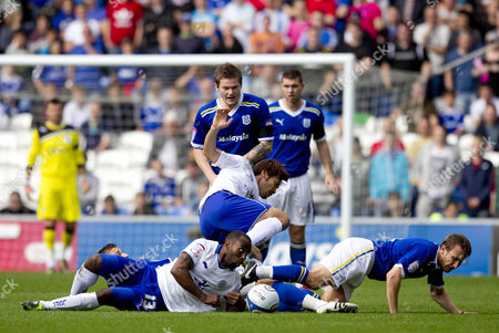 Stock Image of Leicester City striker Darius Vassell and Cardiff City defender Lee Naylor lie on the floor as other players battle for the ball
