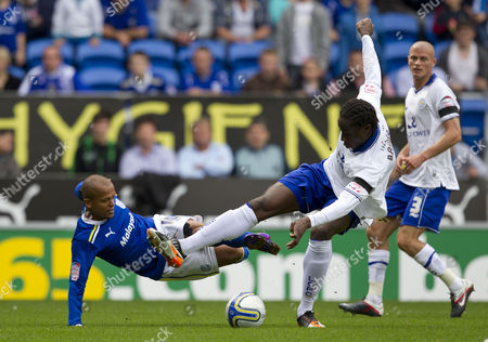 Cardiff City striker Robert Earnshaw goes down in the penalty area under the challenge of Leicester City defender Sol Bamba, no penalty was given
