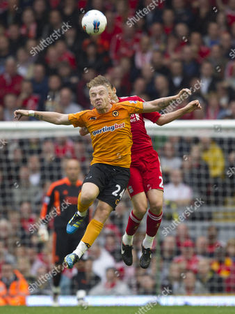 Jamie O'Hara of Wolverhampton Wanderers jumps with Lucas Leiva of Liverpool