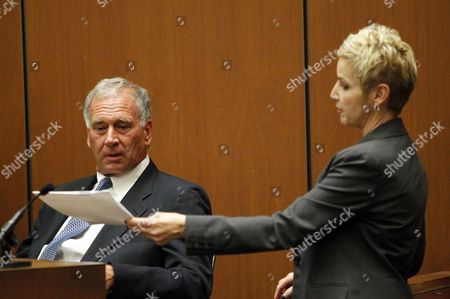 Paul Gongaware, Co-CEO of AEG Live and Concerts West, is questioned by Deputy District Attorney Deborah Brazil