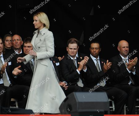 Stock Image of Tiger Woods Looks Towards Di Stewart The Presenter During The Opening Ceremony. Down Boy! The 2010 Ryder Cup Celtic Manor .