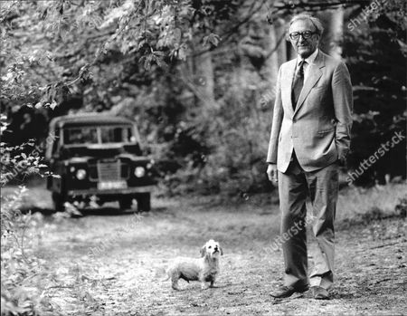 Lord Carrington/baron Carington Of Upton Standing Relaxed With His Hand In Pocket Photographed With His Dog No Date Given