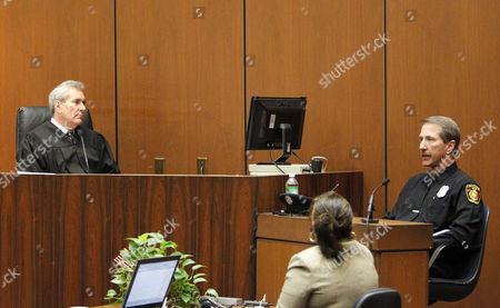 Judge Michael E Pastor listens as Paramedic Richard Senneff gives evidence