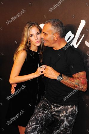 Christian Audigier and girlfriend Nathalie Sorensen