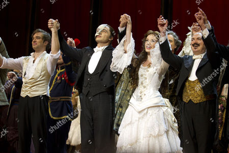 Hadley Fraser (Raoul), Ramin Karimloo (The Phantom of the Opera), Sierra Boggess (Christine Daae) and Barry James (Monsieur Firmin) during the curtain call