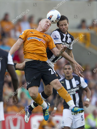 Jamie O'Hara of Wolverhampton Wanderers and Yohan Cabaye of Newcastle United in action