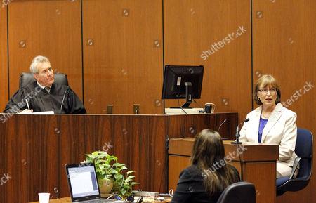 Judge Michael E Pastor listens as prosecution witness Dr Joanne Prashad gives evidence