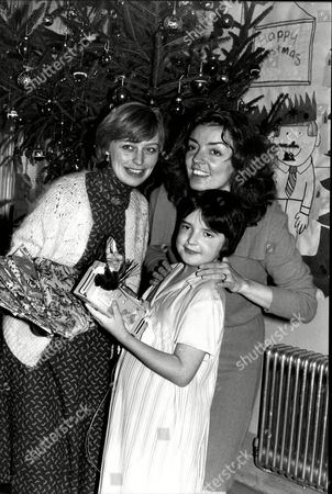Editorial image of The Ray Cooney Presentations At Great Ormond Street Hospital For Children Actress Eva Lohman Left And Actress Of The Year Elizabeth Quinn With Young Clare Hunn At Patient At The Hospital