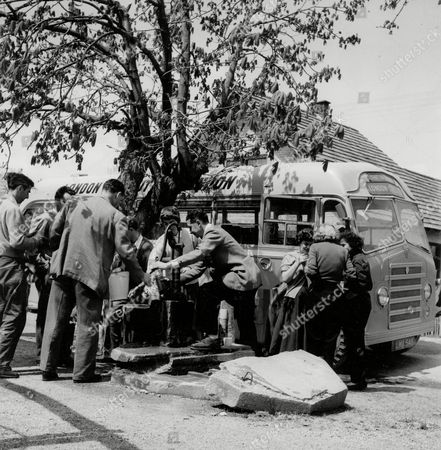 Editorial image of London To Calcutta Bus Trip 1957 (london To India By Bus) The Coach Full Of 20 British During Their Trip Water Stop In Yugoslavia