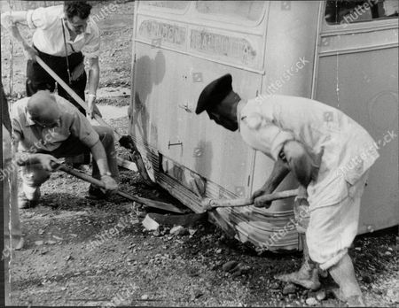 London To Calcutta Bus Trip 1957 (london To India By Bus) The Coach Full Of 20 British During Their Trip A Roadworker Helps With His Pick-axe After The Bus Wheels Were Bogged Down In Mud In Persia